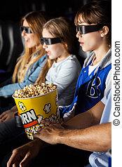 Family Enjoying 3D Movie In Theater
