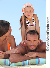 Family enjoying a day out at the beach
