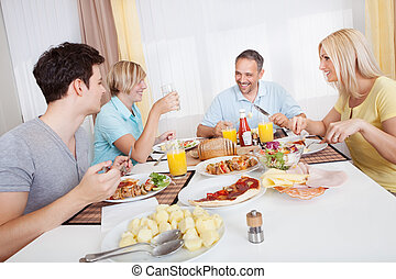 Family enjoying a meal together