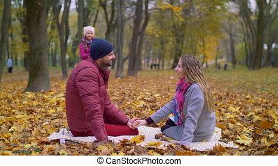 Family enjoying beautiful autumn day in nature - Cheerful...