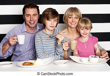 Family enjoying breakfast at a restaurant