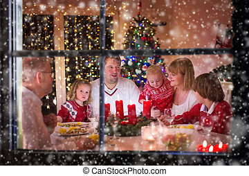 Family enjoying Christmas dinner at home - Big family with...