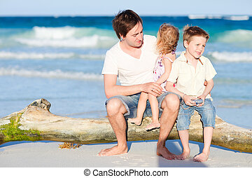 Family enjoying evening by the sea