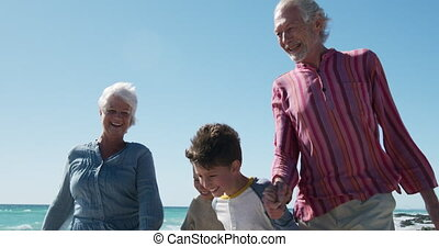 Family enjoying free time on the beach together - Low angle ...