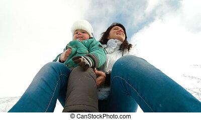 family enjoying in snow
