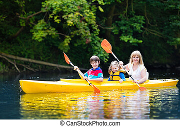 Family enjoying kayak ride on a river