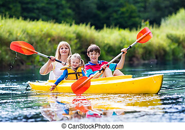 Family enjoying kayak ride on a river - Happy family with ...