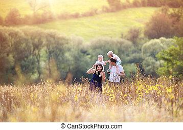 Family enjoying life together outside - Happy family...