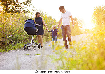 Family enjoying life together outside - Happy family on a...