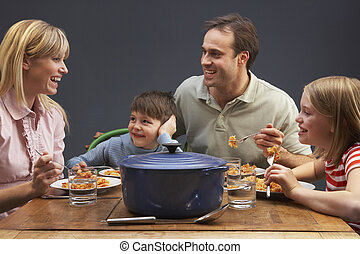 Family Enjoying Meal Together At Home