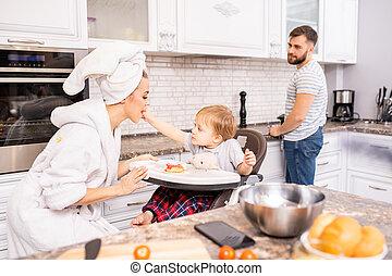 Family Enjoying Morning in Kitchen