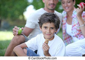Family enjoying outdoors picnic