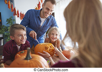 Family enjoying the preparations for Halloween