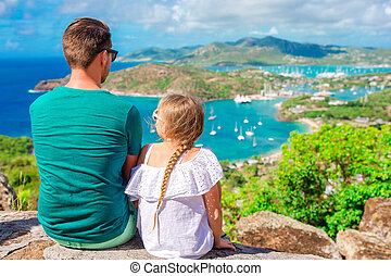 Family enjoying the view of picturesque English Harbour at Antigua in caribbean sea