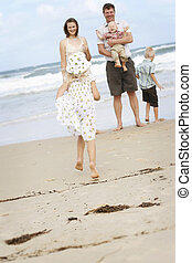 Family enjoying themselves at the beach.