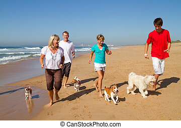 family exercising on beach