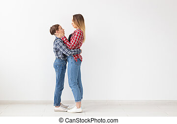 Family, fashion and mother day concept - Mother embrace her son over white background with copy space