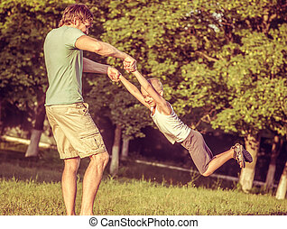 Family Father Man and Son Boy playing Outdoor Happiness emotions Lifestyle with summer nature on background