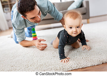 happy little baby girl with father at home