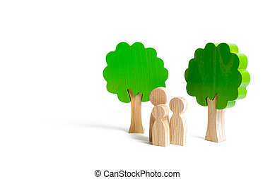 Family figures are standing near the trees. Walk in nature, relaxation and family time. Psychological and physical recreation, trip out of town. Unity with nature. Healthy strong children and parents.
