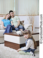 family finance - young parrent at home with beautiful child...
