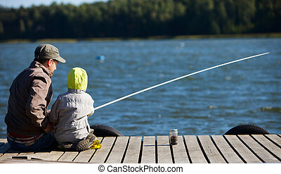 Family fishing - Father and small son fishing together on ...