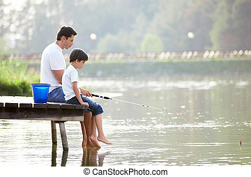 Family fishing - Man and boy fishing on the lake