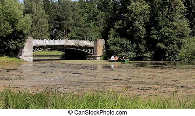 Family floating in a rowing boat