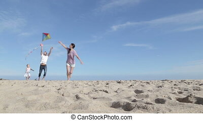 Family Flying a Kite on the Beach