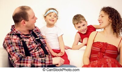 Family four with two children communicate