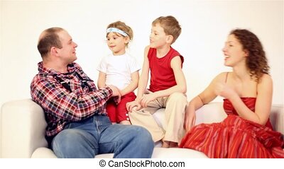 Family four with two children talk