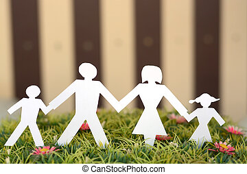Family from paper on grass