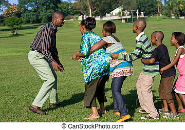 a family playing a game of catch
