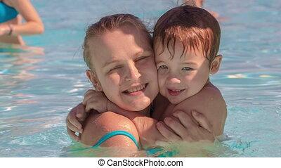 Family fun in the swimming pool