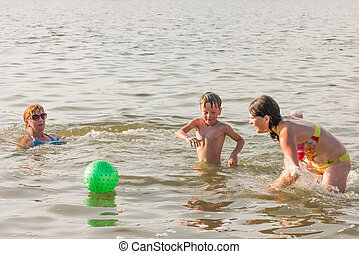 Family fun on the river in summer