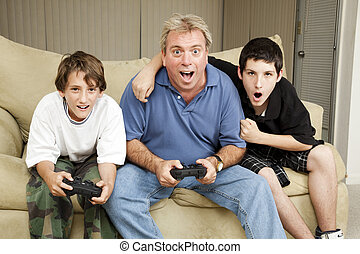 Family Game Night - Uncle playing video games with his...