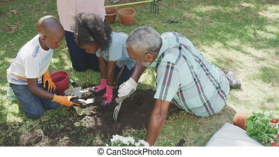 Family gardening during a sunny day