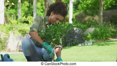 Family gardening together - Front view of a happy African ...