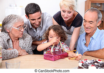Family gathered around table for birthday