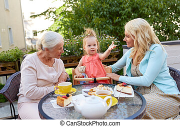 mother, daughter and grandmother at cafe