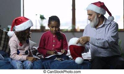 Family getting ready to play secret santa on xmas - Joyful...