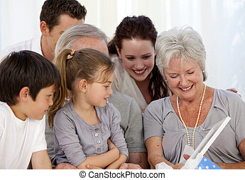 Family giving a present to the grandmother