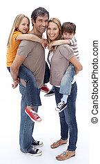Family giving children piggyback ride - Family giving...