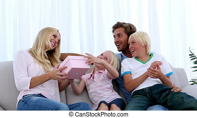 Family giving mother a pink present
