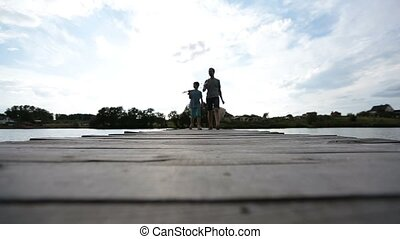 Family going fishing on the lake in summer