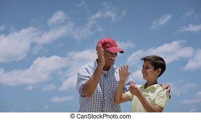 Family Grandpa Teaching Boy To Fly Kite Slowmotion