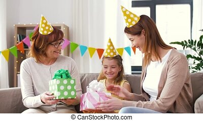 family greeting girl with birthday at home party - family,...