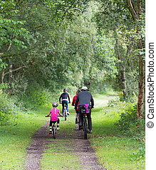 family cycling in the Consall Valley popular with tourists in Staffordshire