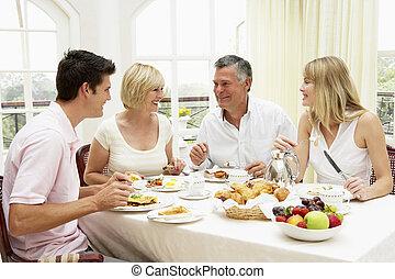 Family Group Enjoying Hotel Breakfast
