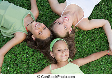 family,. happy group of smiling sisters or young mum with kids